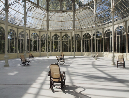 velazquez: Crystal Palace is a glass and metal structure in rocking chairs you can relax and read a book Editorial