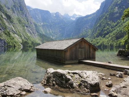 Boat hangar on Obersee mountain lake in Alps. Stock Photo