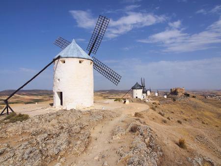 mancha: White windmills on the hill near the castle in Consuegra, Toledo province, SpainCAMERA Stock Photo
