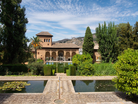 Alhambra patio with pool, day,sunny, clouds Stock Photo