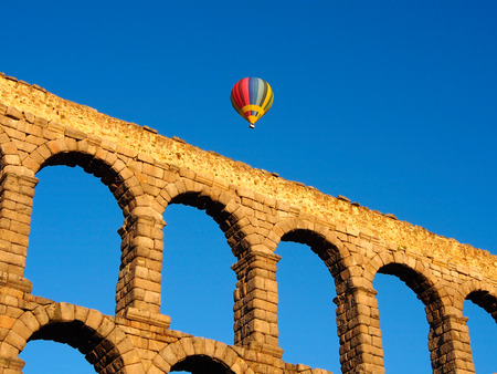 Balloon over aqueduct  in the sky of the city of Segovia in the morning Stock Photo