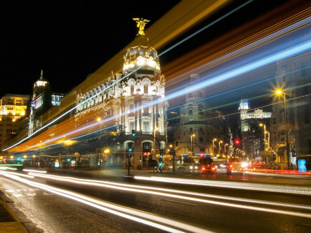 gran via: Gran Via, main shopping street in Madrid, traces of the lights of cars and the bus