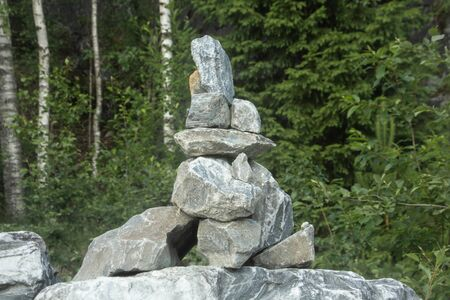 heap of stones called CAIRN in the Ruskeala Park, Republic of Karelia, Russia. This stack indicates the right way