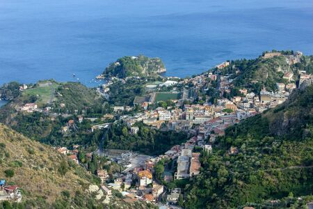 The view from village Castelmola at mountain, view of Mediterranean Sea and the skyline of Taormina.