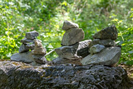 The heap of stones called CAIRN in the Ruskeala Park, Republic of Karelia, Russia. This stack indicates the right way