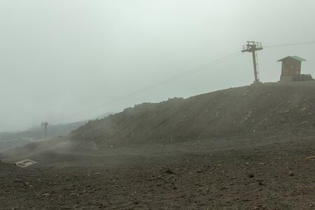 Landscape of Etna with cable car in the fog, Sicily, Italy