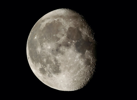 Moon, earth satellite in the night sky in the vastness of the deep space