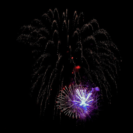 fire crackers: Night fireworks different colors on a black background. Can be used for mounting.