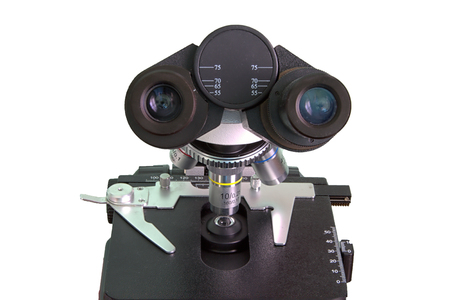 cytology: Microscope on a white background. The image close-up images of the adjustment mechanisms and objctive. Isolated. Stock Photo