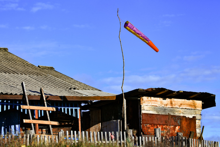 Supplies a wind sock paragliding. Mounted on a long mast above the village house.