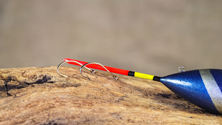 Fishing gear. Illustrative material for the fishing theme. Float tackle. Feathers for knitting flies. Stock Photo