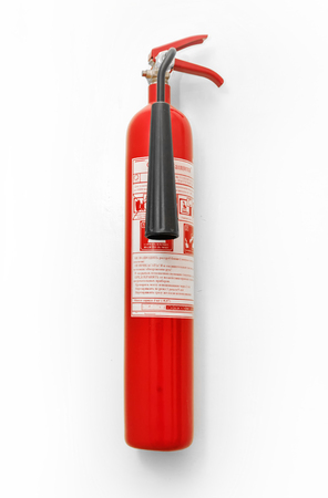 extinguishing: A fire extinguisher hanging vertically on the wall. White background. For photomontage and collage. Stock Photo