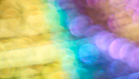 Colorful bokeh. Blurred background in IDA bright colorful spots. Round patches of all colors of the rainbow. A romantic mood. Bright colored background. The defocusing. Stock Photo