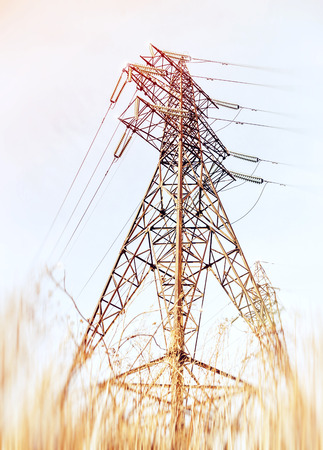 The tower of power. Removed from a low point. High-voltage wires diverge in different directions. Steel structure upward.