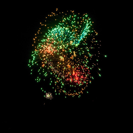 fire crackers: Fireworks in the night sky. Colored lights on a black background. Celebration and joy. New years fireworks. The fire show.