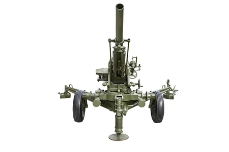 howitzer: Artillery gun. Gun of the second world war. Green rubber inflatable wheels. Long rifled barrel. Isolated on white background.