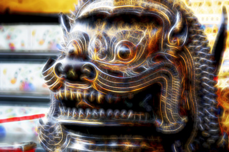 Chinese lion. The stylization of the sculpture. Grinning teeth. Oriental exoticism and culture.
