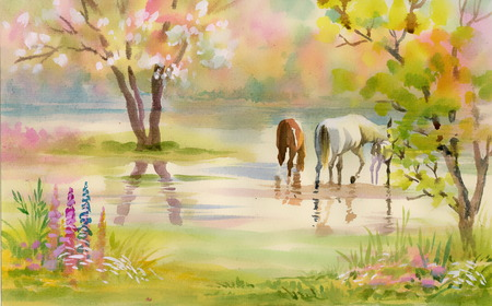 Two horses graze among the trees in the garden
