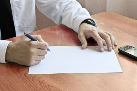 Man Writing In Office photo