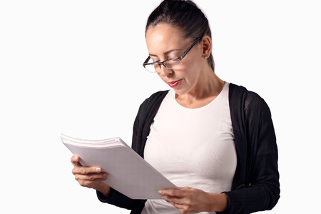 reviewing documents: Businesswoman reviewing documents Stock Photo