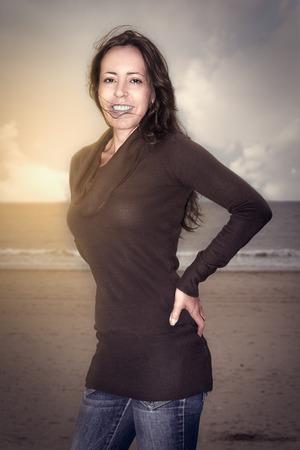 lächelnde Frau in der Küsten