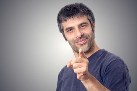 Happy man pointing finger with index finger Standard-Bild