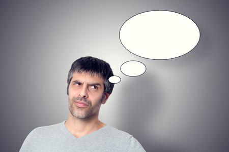 Man thinking on gray background