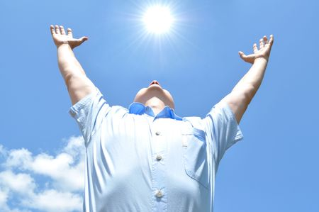The young man held out his hands to heaven, freedom Stock Photo - 8259944