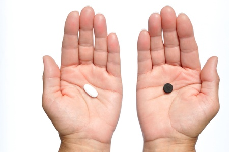 longevity drugs: On the one hand, white pill, on the other black Stock Photo