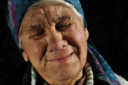 poor woman: Crying, elderly woman, isolated black background