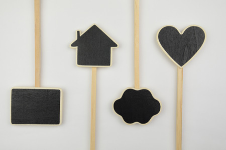 Small layouts, icons cloud, heart, and house on white background photo