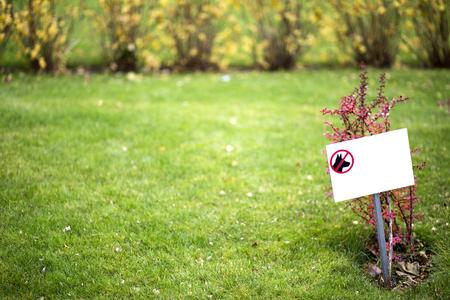 sign on grass Фото со стока