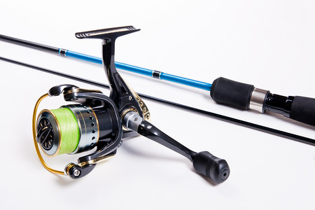 fishing equipment: Fishing rod with fishing reel isolated on white Stock Photo
