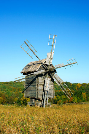 ethnographic: Old wooden windmills at Pirogovo ethnographic museum and autumn landscape at the background, near Kyiv, Ukraine