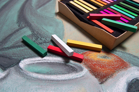 graphic artist: Artist's chalk pastels and original pastel drawing of still life on the background. Stock Photo