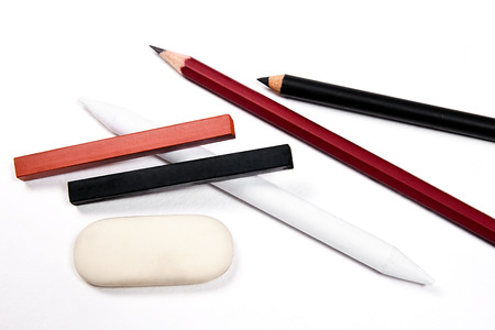 sanguine: Assorted Art Tools. Pencils, eraser, stamp, chalk of sanguine and charcoal. Isolated over white background.
