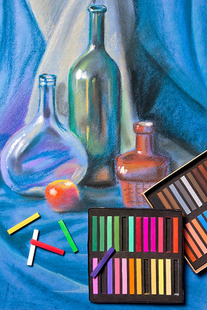 colorfull: Artists chalk pastels and original pastel drawing of still life on the background.