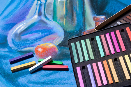 pastel drawing: Artists chalk pastels and original pastel drawing of still life on the background.