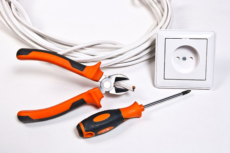 power tools: Wall socket, power cable and electrician tools on white background