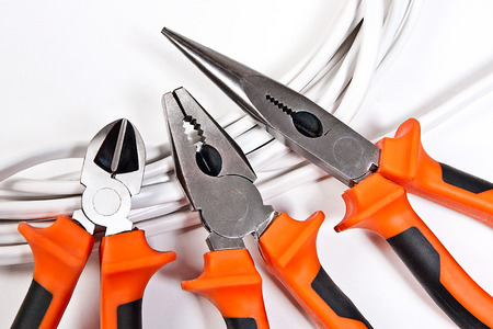 stripper: Metal pliers, insulation stripper pliers for insulating electric wires, on white background, work tools for engineering