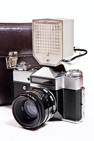 finder: Old range finder vintage camera with flash isolated on white. Old camera flash with a leather case isolated on a white background.