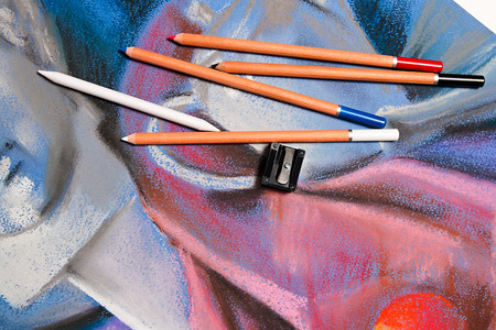 pastel drawing: Pastel pencils and original pastel drawing of still life on the background. Stock Photo