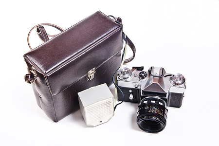 finder: Old range finder vintage photo camera with flash isolated on white. Old camera flash with a leather case isolated on a white background. Stock Photo