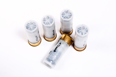 sports shell: Four cartridges for hunting rifle isolated on white background.