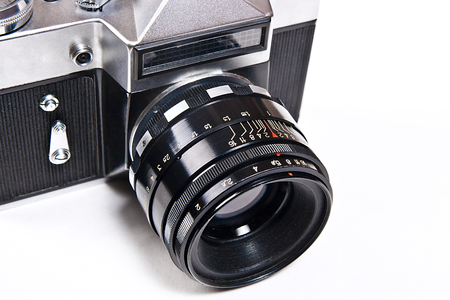 finder: Range finder camera with lens. Close up view part of old retro photo camera. Classic black manual film camera isolated on white background.