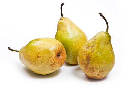 pear: Three fresh green pears. Group of juicy ripe fruits. View of conference pear isolated on white background.