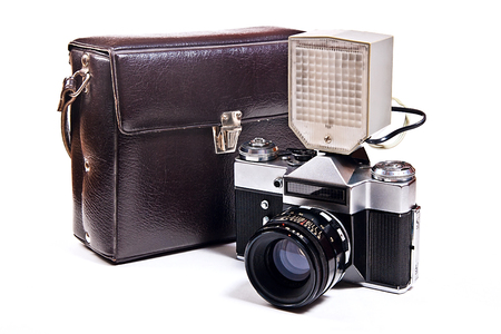 viewfinder vintage: Old range finder vintage photo camera with flash isolated on white. Old camera flash with a leather case isolated on a white background. Stock Photo