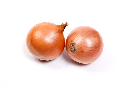Fresh onions vegetables on white background. Arrangement of two ripe fresh onions isolated on white background.