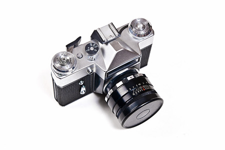 finder: Range finder photo camera with lens. Classic black manual film camera isolated on white background. Stock Photo