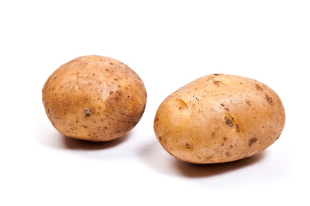 thee: Thee Potatoes isolated on white background. Stock Photo